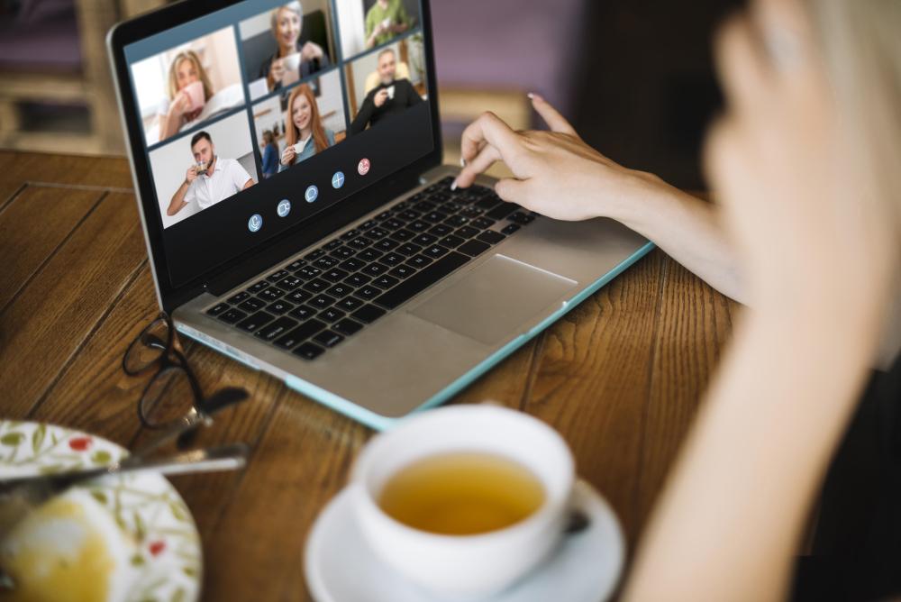 sideways-video-call-on-laptop-outside